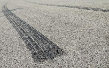 bolid: burned rubber tire track on an asphalt road-close up
