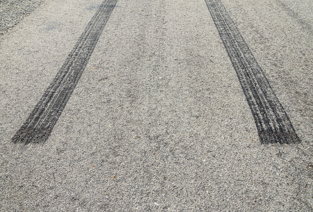 burned rubber tire track on an asphalt road-close up photo