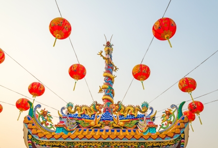 Chinese style dragon statue on the genaral temple roof with Chinese style lantern photo
