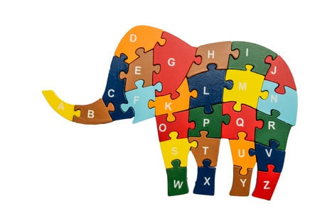 Colorful puzzle pieces in elephant shape isolated over white