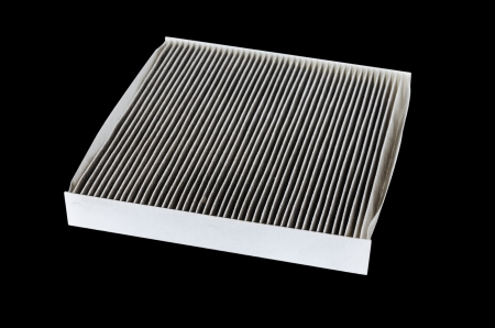 car cabin filter isolated on black photo