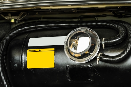 liquefied: black car liquefied petroleum gas, LPG  tank with meter close up Stock Photo