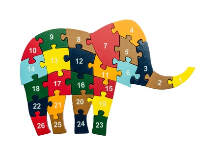 Colorful puzzle pieces in elephant shape isolated over white photo