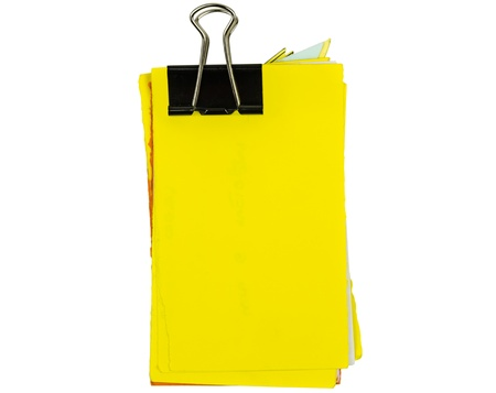 untidy yellow notepad with binder isolated Stock Photo - 20363397