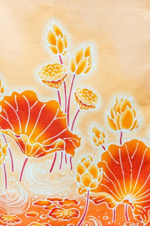 lotus pattern paint on a batik design on shirt textile from Thailand Stock Photo