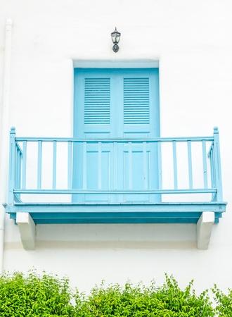 resplendence: renovated facade blue balcony  on white wall