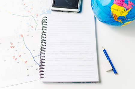 Vacation planning with map, marker and agenda