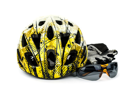 Bicycle helmet, glasses and cycle gloves isolated on white background photo