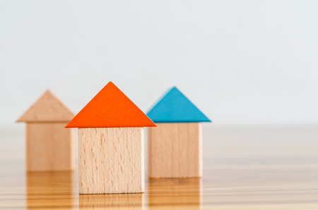 Wooden building blocks-home concept.