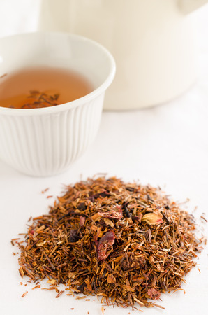 rooibos: rooibos tea - red tea with strawberry and flower petals Stock Photo
