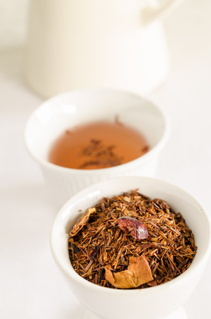 stimulator: rooibos tea - red tea with strawberry and flower petals Stock Photo