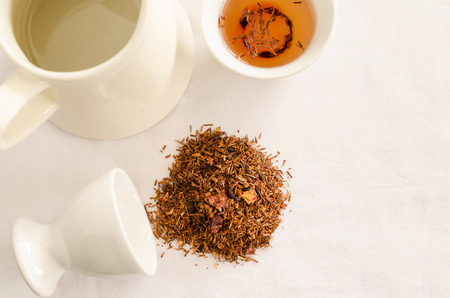 red tea: rooibos tea - red tea with strawberry and flower petals Stock Photo