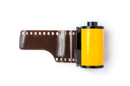 the photo: photo film in cartridge isolated on white