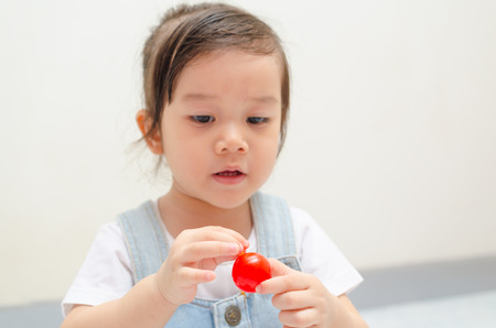 pratice: little asian girl playing rope and ball