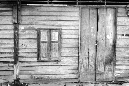 chiangmai: Old wooden door and window in local Thailand, house wall.