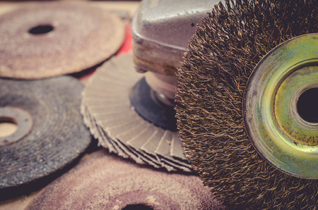 grinding teeth: Old abrasive disks for metal and stone grinding, cutting - close up.