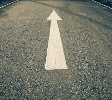solutions freeway: White  arrows on the street - forward arrow sign Stock Photo