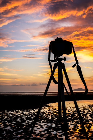 puckered: Camera and tripod on the sunset in Trang province,Thailand