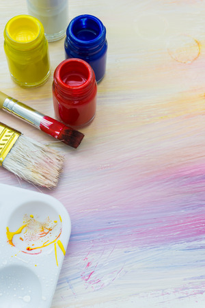 creativity artist: artist brushes and paints  on an abstract artistic background Stock Photo
