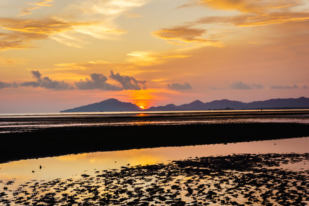 puckered: sunset on the beach in Trang province,Thailand Stock Photo