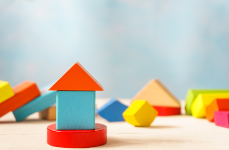 wooden toy: Wooden building blocks-home concept.