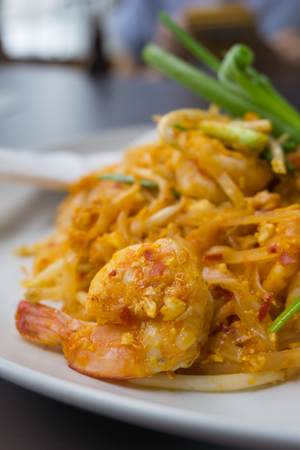peanut sauce: Thailands national dishes, stir-fried rice noodles with egg, vegetable and shrimp (Pad Thai)