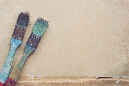 old furniture: Paintbrush on grunge paper background. Stock Photo