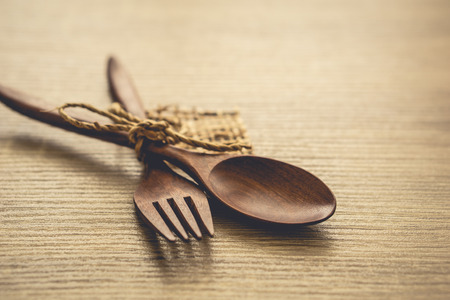 Serving spoons on wooden surface Stock Photo