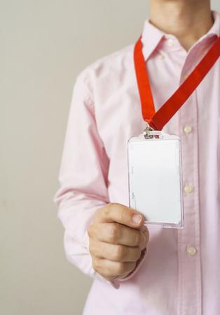 Man holding Identification white blank plastic id card. Zdjęcie Seryjne