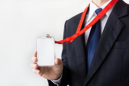 Man holding Identification white blank plastic id card. 写真素材