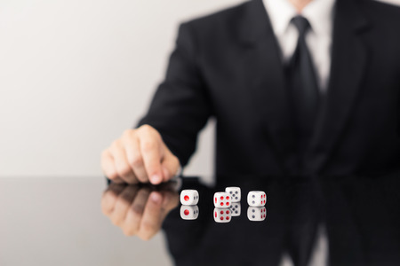 Businessman and dices  - business risk,inconsistency concept.