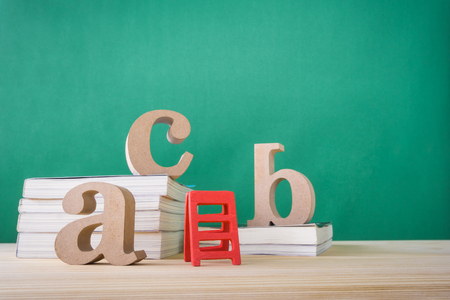 Concept of education or back to school on green background Reklamní fotografie