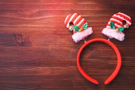 Christmas background with headband on wooden board.