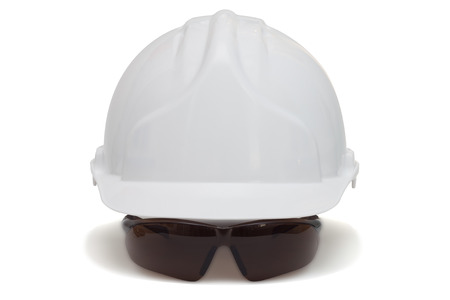 safety goggles: Construction helmet and safety goggles on white background