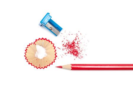 sharpened: Sharpened pencil, shavings and sharpener on white background