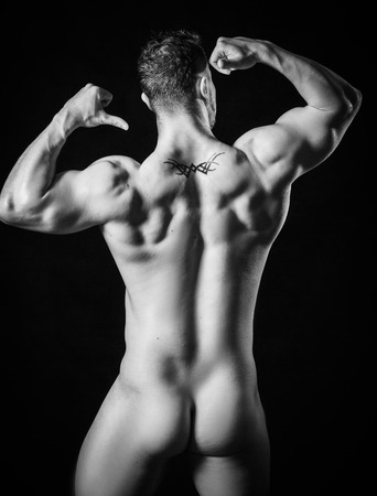 man ass: Muscled male model with strong arms. man is back