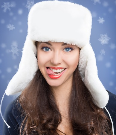 beautiful girl in winter hat. on snow  photo