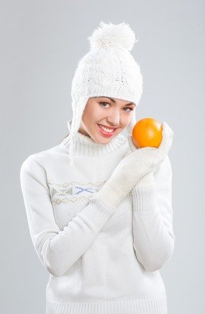Beautiful young woman in winter clothes on. smiling photo