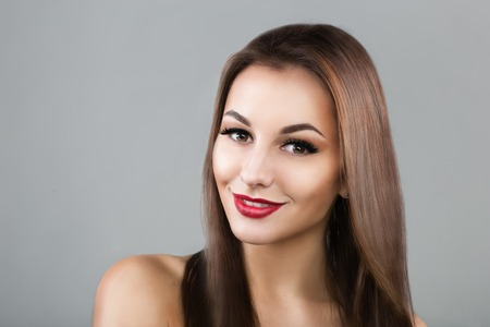 Photo of a beautiful woman with long straight brown hair looking