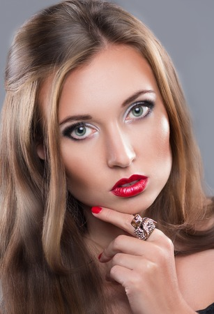 girl with red lips and chic hair. close-up portrait photo