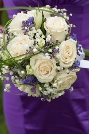marriageable: beautiful wedding bouquet of roses girl holding Stock Photo