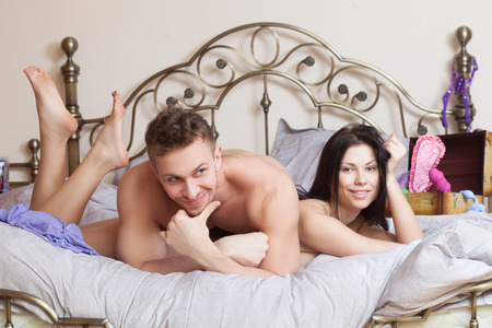 nude in bed: sexy couple lying in bed  Stock Photo