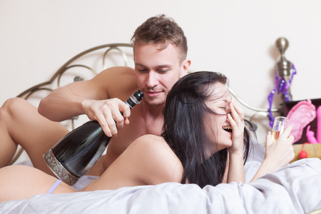 nude sex: sexy couple lying in bed  Stock Photo