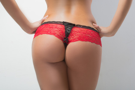 Woman s sexy buttocks in a bikin photo