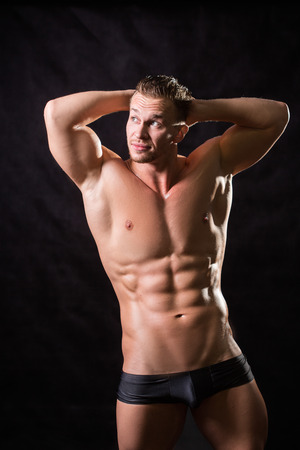 pectorals: beautiful bodebilder on a black background