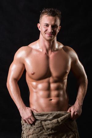 Bodybuilder in einer Tasche Standard-Bild - 31215331