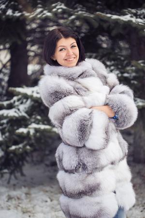 blue grey coat: Winter Girl in Luxury Fur Coat Stock Photo