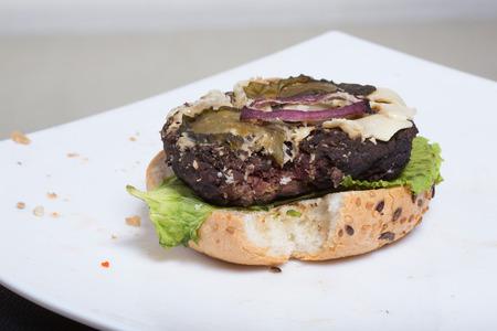 addle: bad burger. bun, burger, salad.