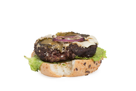 addle: bad burger. bun, burger, salad. inedible food Stock Photo