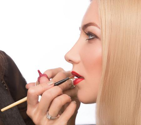 Make-up artist apply bloody lipstick photo